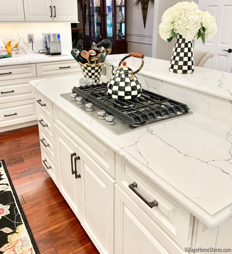 "KitchenAid 30"" 5 burner gas cooktop with griddle in a Quad Cities area kitchen. Quartz surfaces, appliances, cabinetry, and complete remodel by Village Home Stores."
