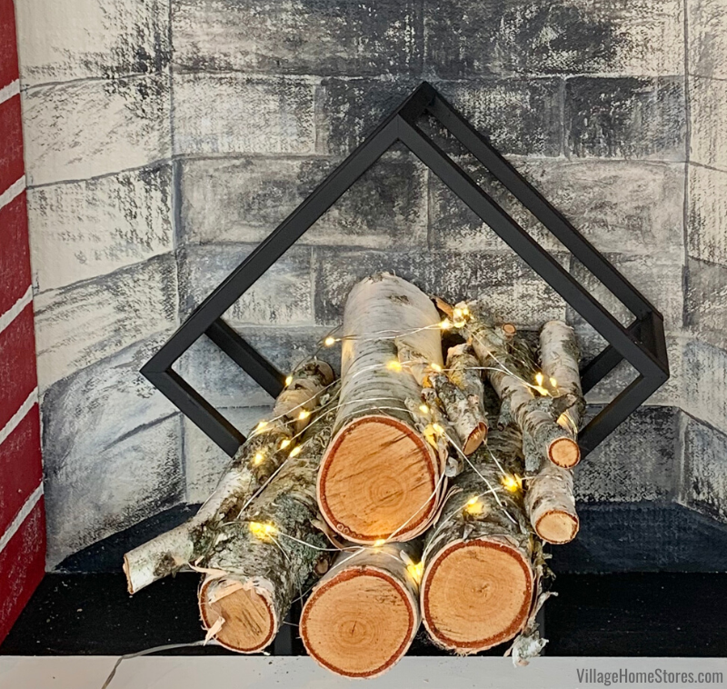 Geometric log holder with birch logs and fairy lights