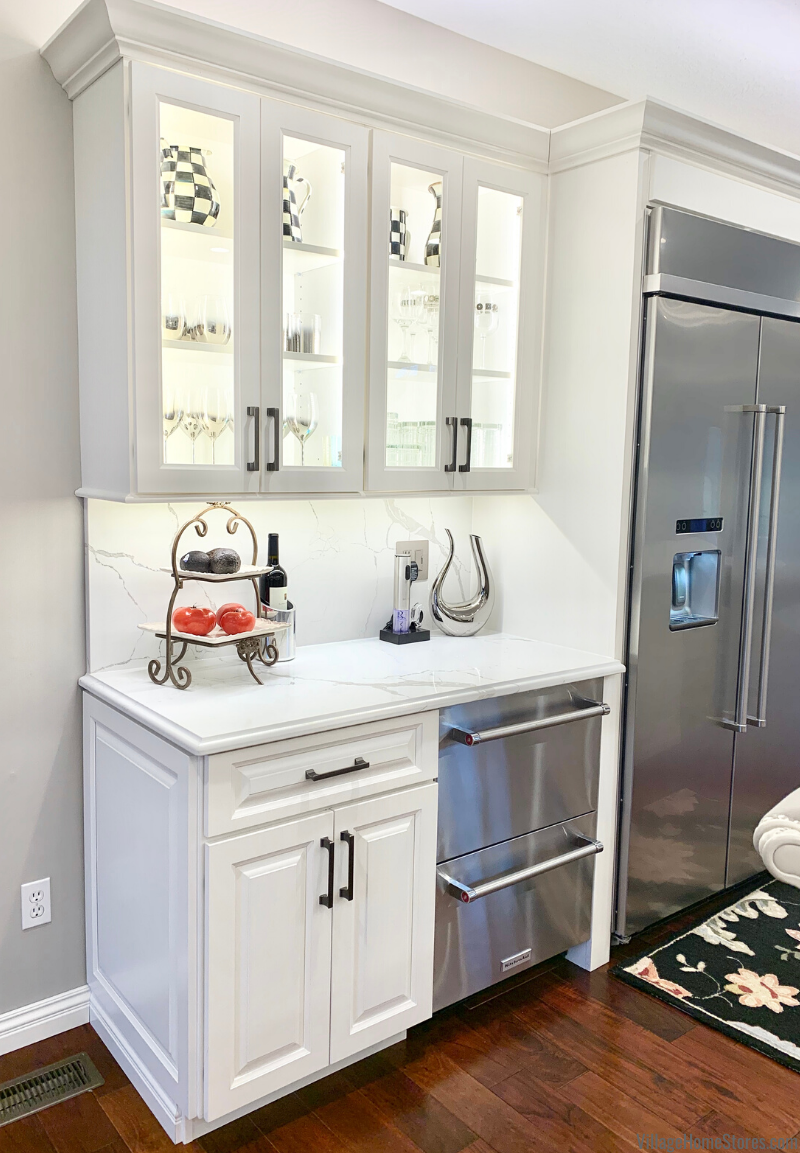 Glass door built in hutch area in a Coal Valley Quad Cities remodeled kitchen. Cabinetry, counters, appliances, lighting, design, and remodel by Village Home Stores