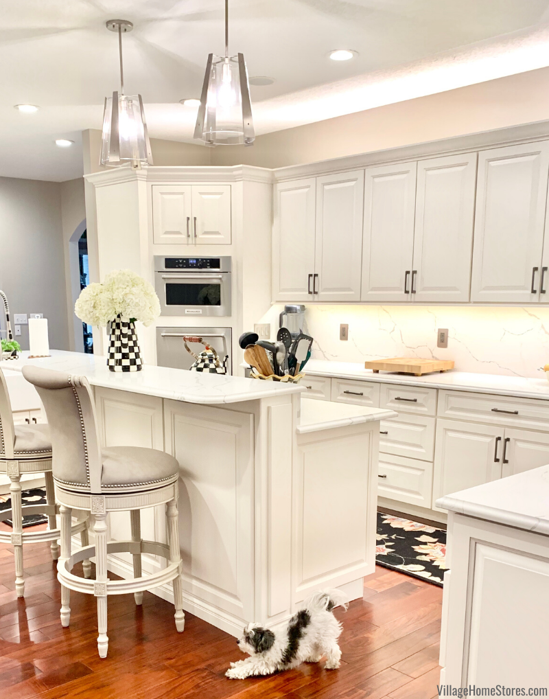 Dual level kitchen island with two pendant lights hanging above. Kitchen remodeled by Village Home Stores
