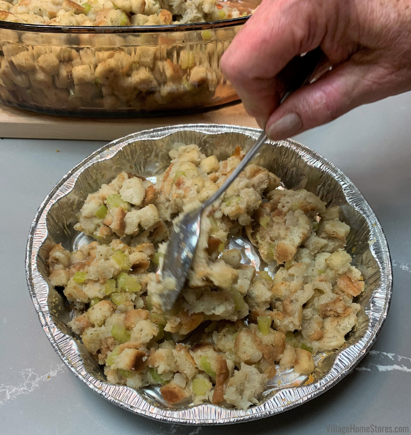 Thanksgiving stuffing packed into a round pan.