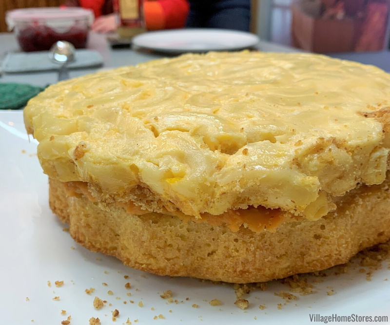 Mashed sweet potatoes help bind layers of corn bread and baked mac and cheese together in our layered side dish cake.
