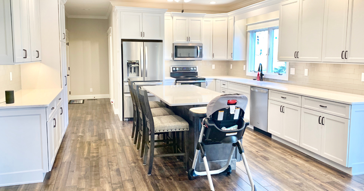 white kitchen with island with highchair