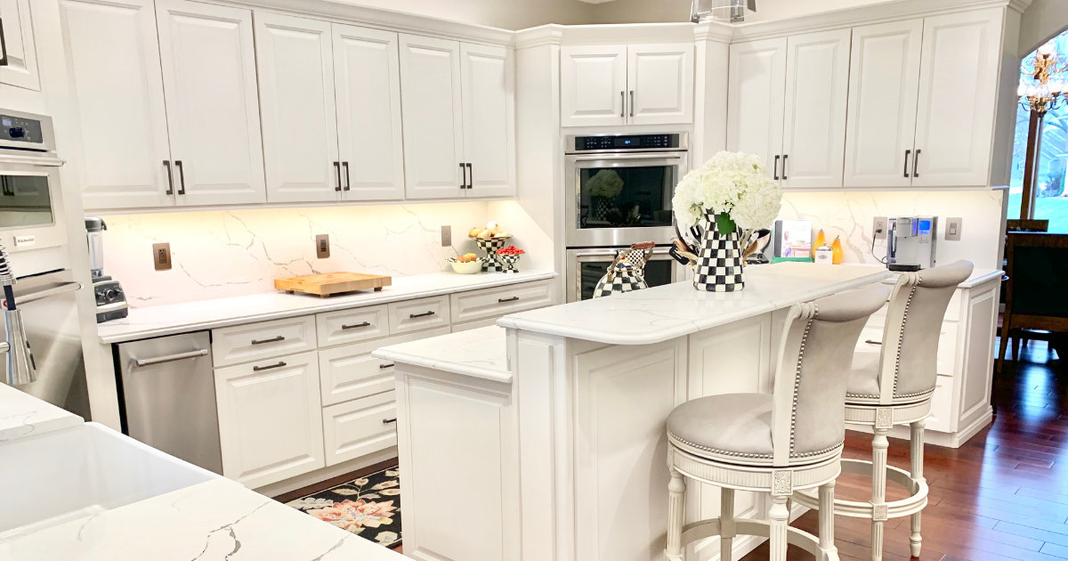 ivory white kitchen with island and barstools