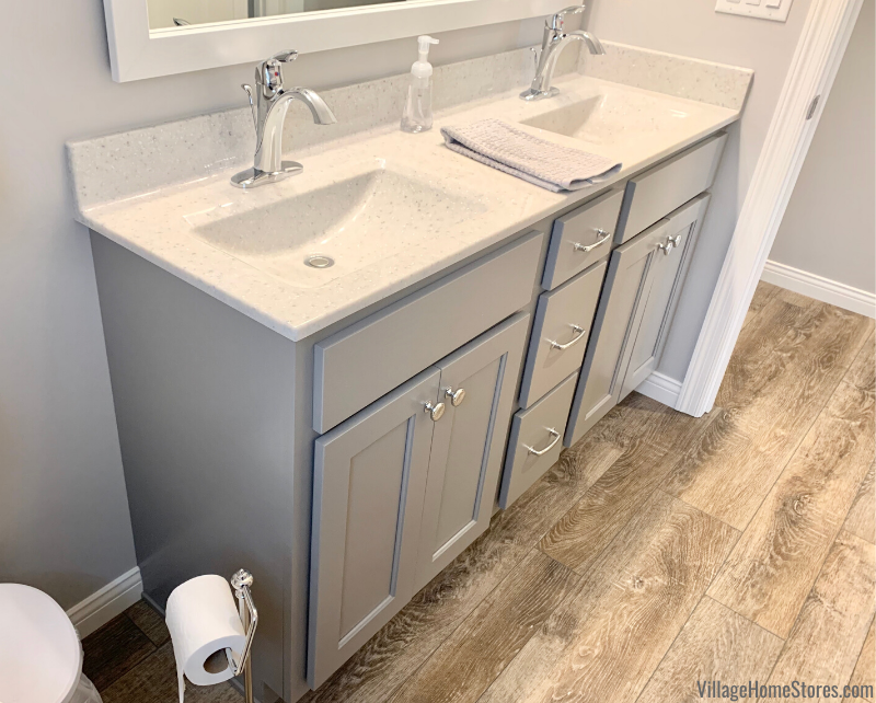 Bathroom double vanity cabinet and Onyx top. Design and products from Village Home Stores for Bob Johnson Construction.