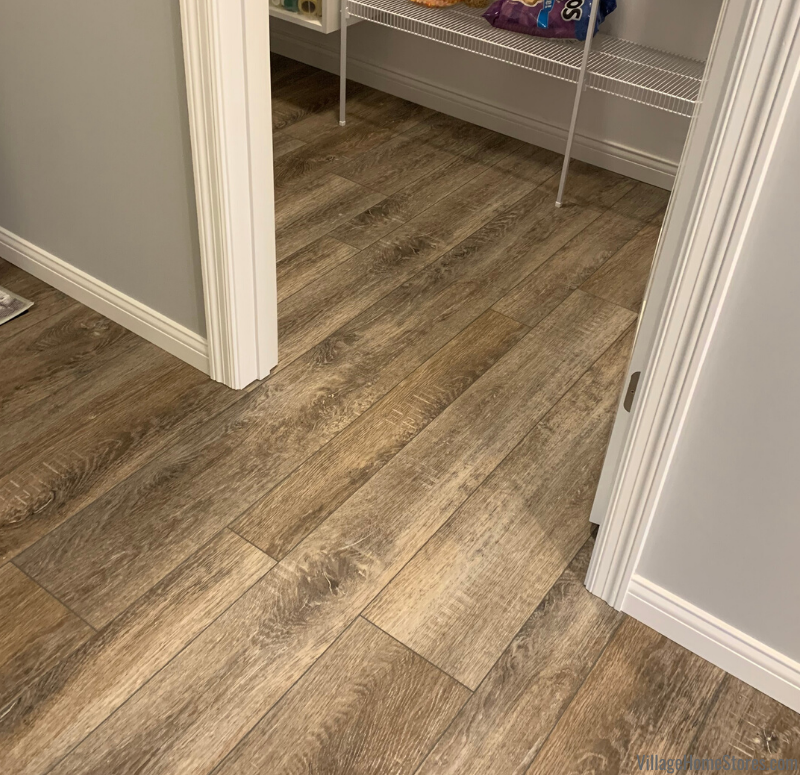 Luxury vinyl plank flooring installed in a Geneseo, IL home. Design and products from Village Home Stores for Bob Johnson Construction.