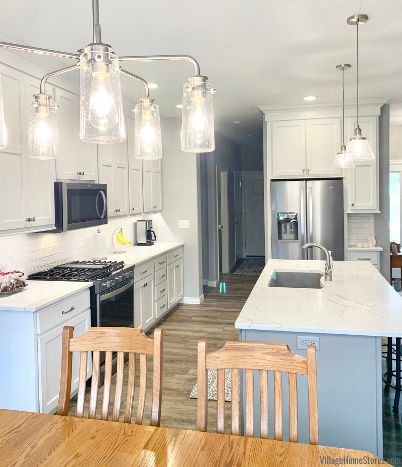 White and gray painted kitchen with Koch cabinetry, Whirlpool appliances, and Calacatta Laza quartz countertops. Kitchen design by Rachel Tingley and products from Village Home Stores.