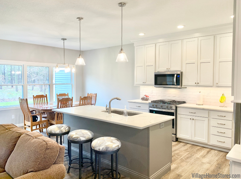 White and gray Fog painted kitchen with Koch cabinetry and Calacatta Laza quartz countertop surfaces. Kitchen design by Rachel Tingley and products from Village Home Stores.
