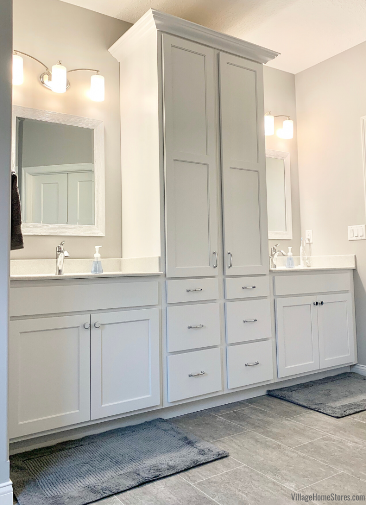 Master bathroom double vanity cabinet layout with tall linen cabinets. Design and products from Village Home Stores for Bob Johnson Construction.