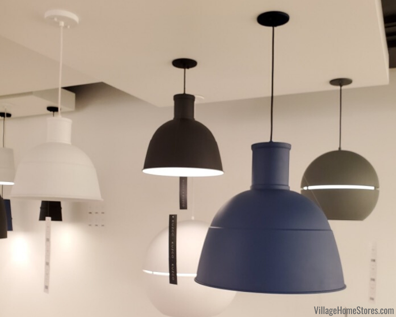 Kuzco Lighting pendants with matte blue, white, and black painted finish options.