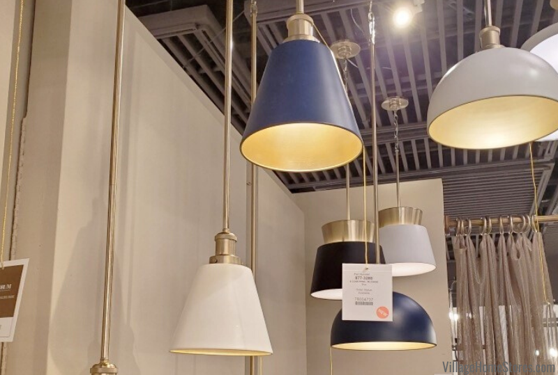 2020 lighting trend of gold peek a book interior. Quorum pendants with blue painted finish options.