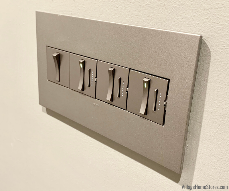 Legrand Adorne collection wall switches with dimmers. Shown installed in Village showroom in Geneseo, IL.