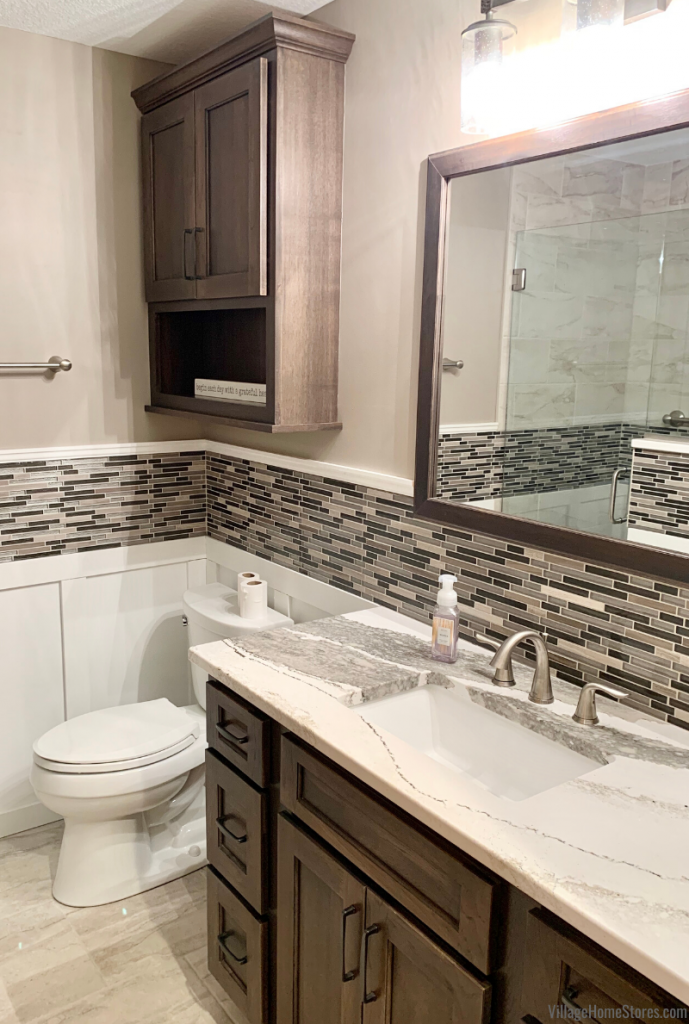 Cambria Skara Brae vanity top and glass wall tile installed in a remodeled Morrison, IL bathroom. Bathroom designed by Angela Weisbrod and remodeled by Village Homes Stores.