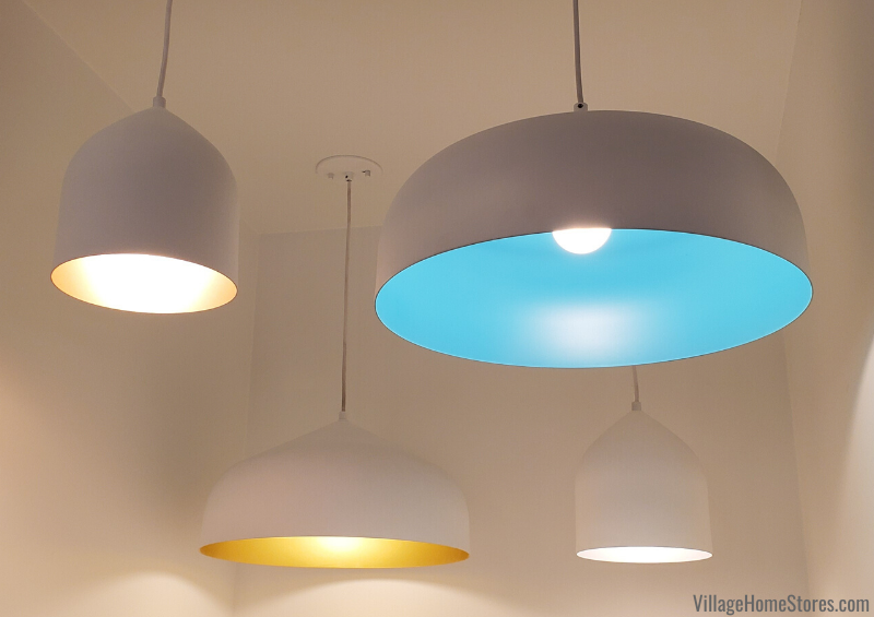 White Kuzco dome pendant lights with playful peek a book interior colors.