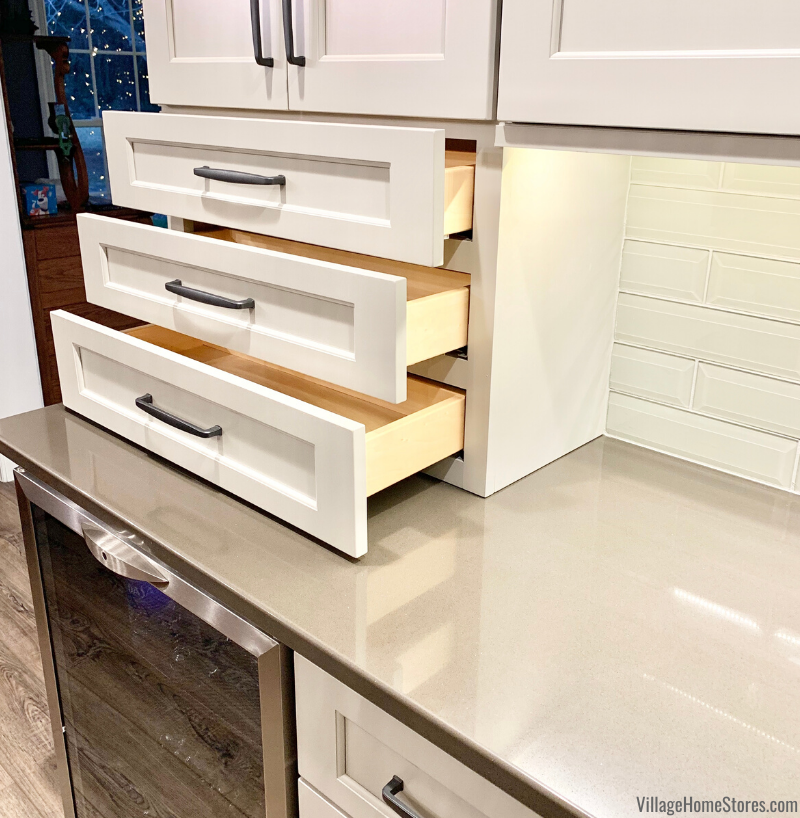 Kitchen wall cabinet with drawers down to countertop.