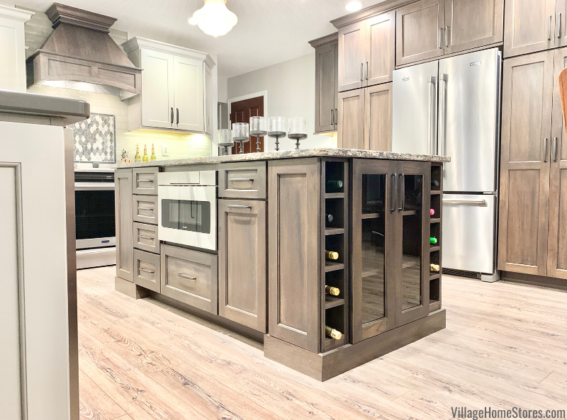 kitchen island with wine bottle storage on end