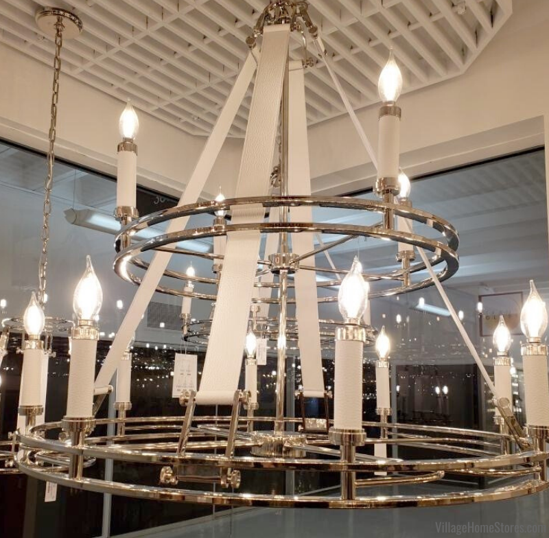 Polished chrome finish chandelier with white leather strap detail. Light by ELK Group International available at Village Home Stores