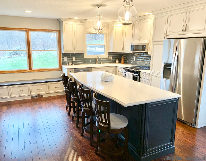 Rock Island Kitchen remodel featuring Acacia floors and painted Oyster and Charcoal Blue painted cabinets.