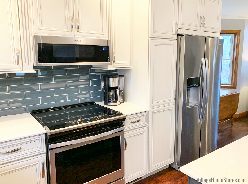 Stainless Steel Whirlpool appliances including low profile microwave hood in a Rock Island Quad Cities kitchen.