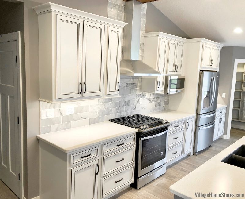 Milan, IL kitchen with Whirlpool appliances and painted and glazed Koch cabinetry.