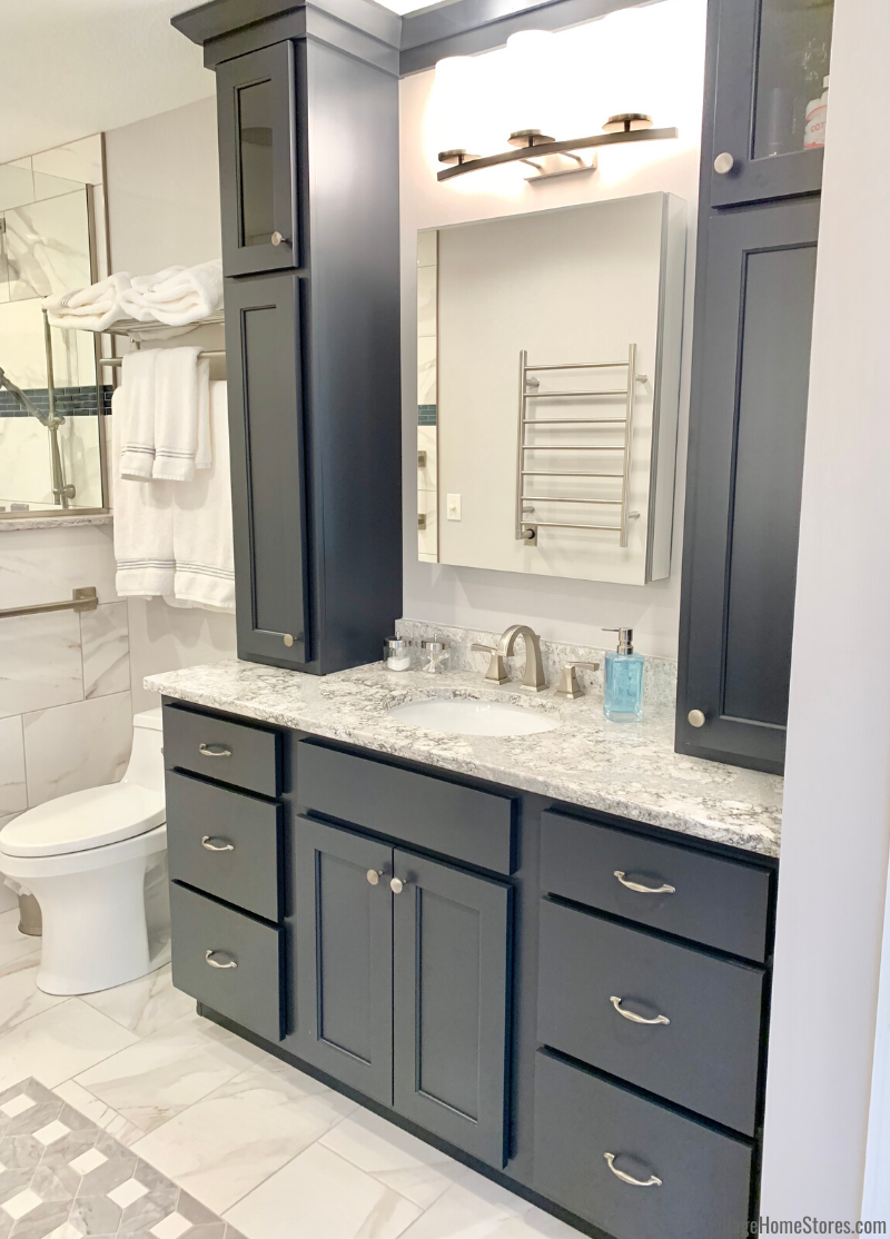Charcoal blue painted vanity cabinets with Cambria Summerhill quartz counters in a Bettendorf Master Bath.