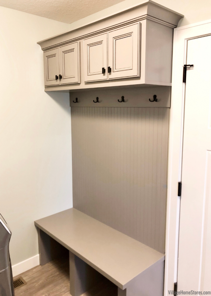 Milan, IL laundry room with drop zone bench.