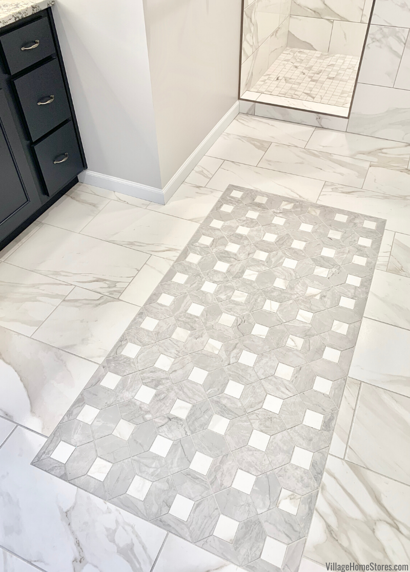 Master bathroom with tiled inlay rug at center