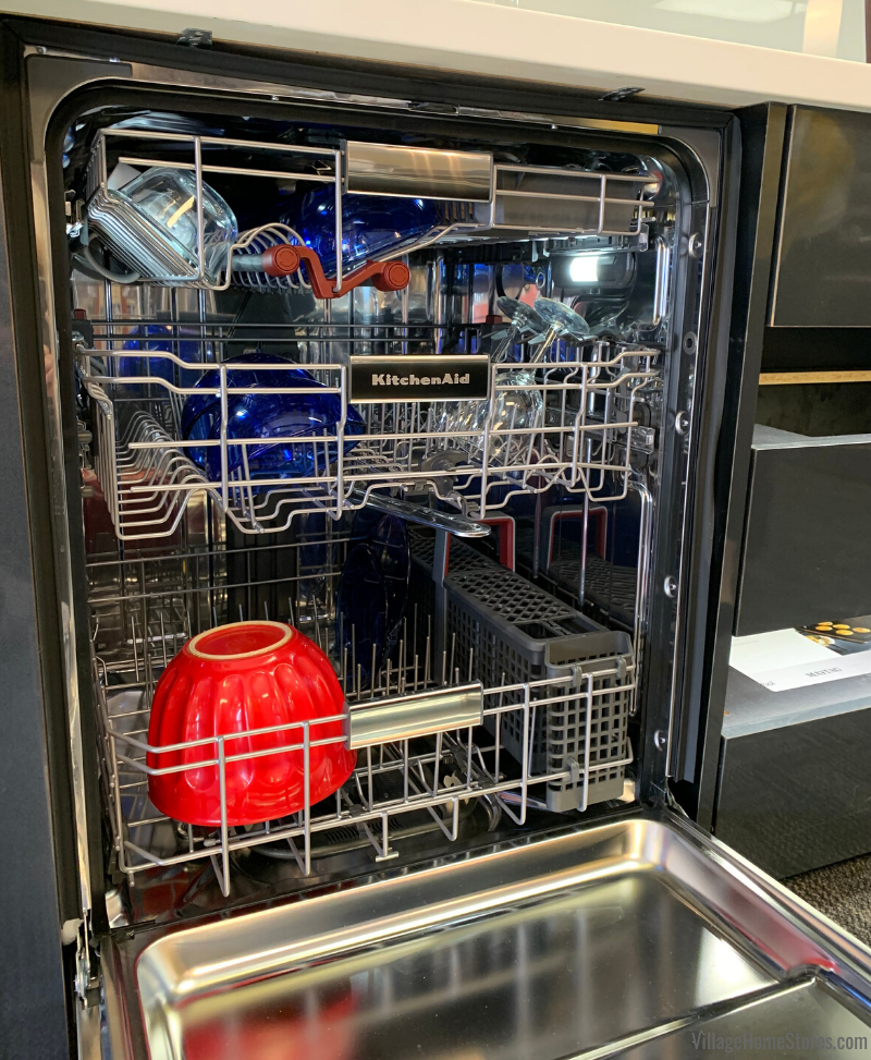 KitchenAid third rack dishwasher interior layout with sani-rinse feature in the Village Home Stores showroom.