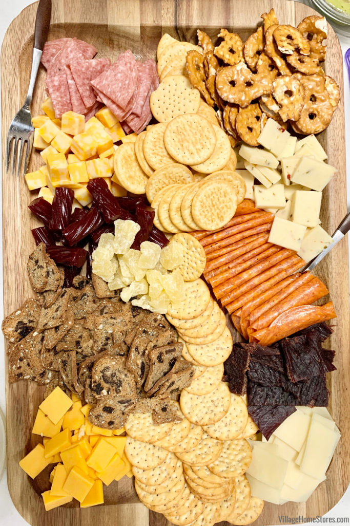 Meats, treats, cheeses, crackers, and other snacks all ready for grazing during your next movie or game night.