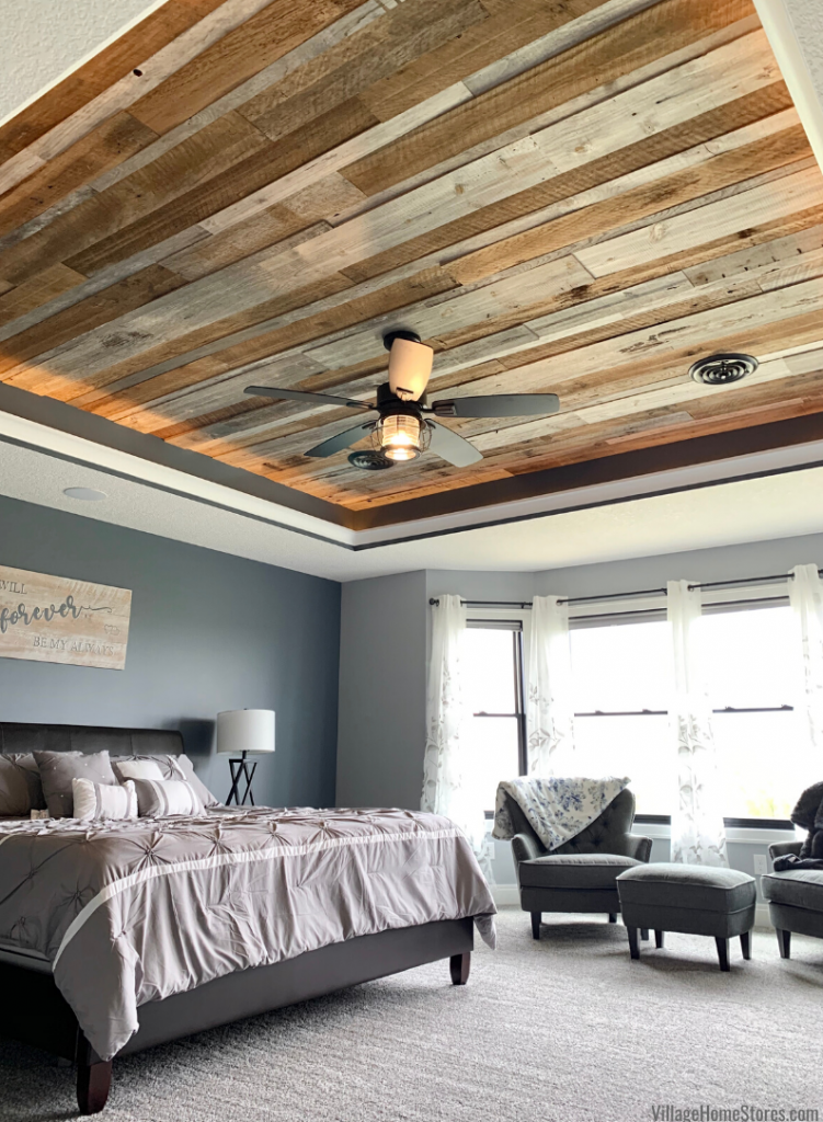 Barnwood ceiling with Galveston farmhouse style fan. Quorum lighting and Dream Weaver Pearl Slate carpeting available at Village Home Stores