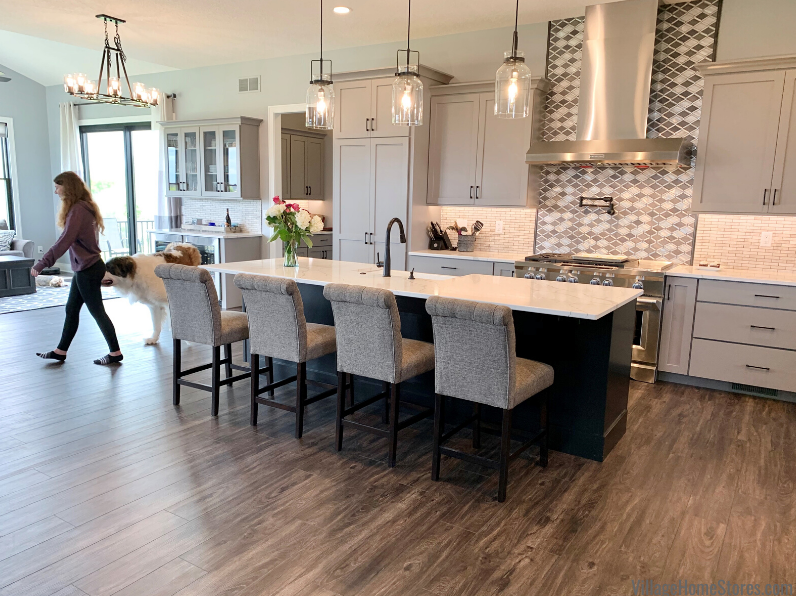 Bettendorf new home kitchen with light gray and black painted cabinets. Kitchen design and materials by Village Home Stores for Kerkhoff Homes of the Quad Cities