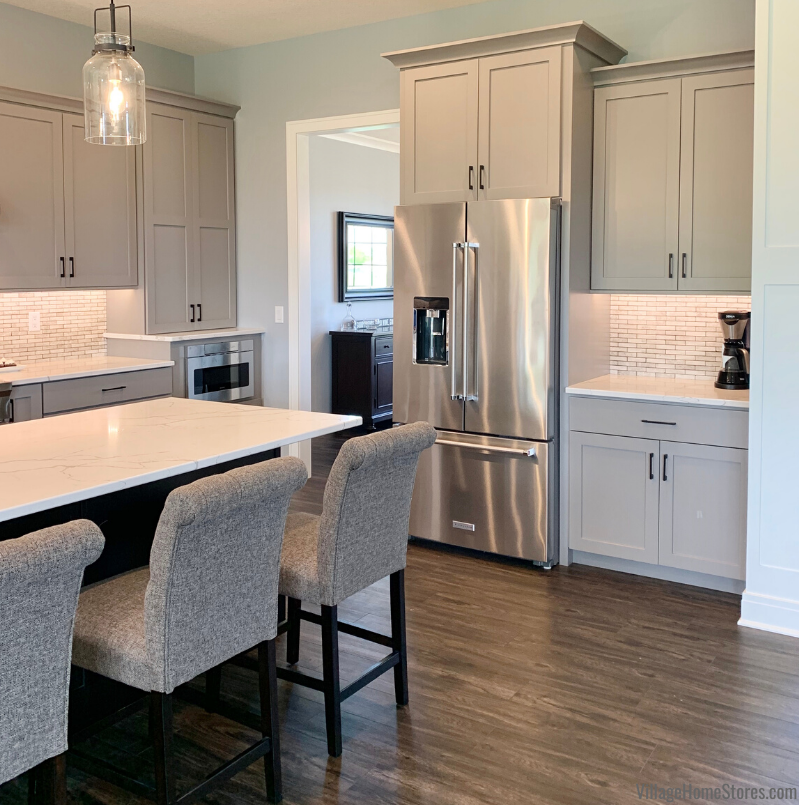 Gray and black painted kitchen with counter depth french door refrigerator from Village Home Stores for Kerkhoff Homes of the Quad Cities