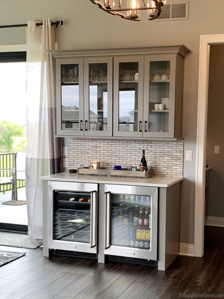 Home bar in kitchen with Kitchen Aid undercounter glass door refrigerators from Village Home Stores for Kerkhoff Homes of the Quad Cities