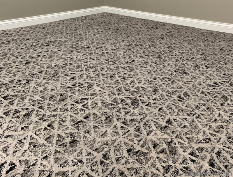 Modern pattern carpeting with a mix of black and gray neutrals in the Village Home Stores showroom.