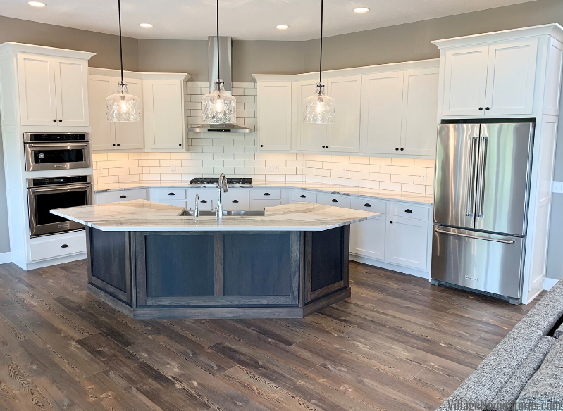 Kitchen design with angled island and Skara Brae Cambria Quartz. Cabinetry, counters, lighting and appliances by Village Home Stores for Bagby Construction