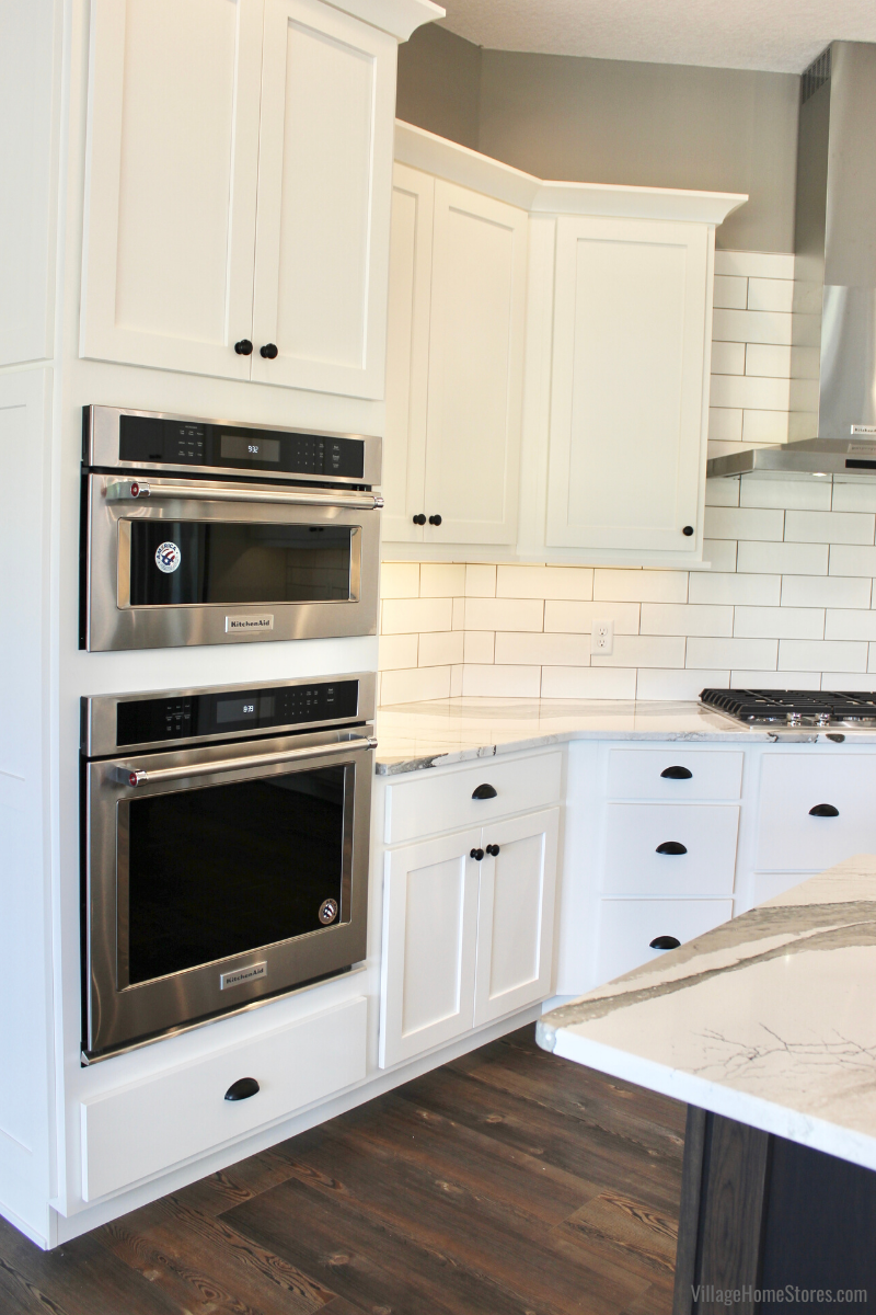 KitchenAid wall oven and built in microwave installed in white painted cabinetry.