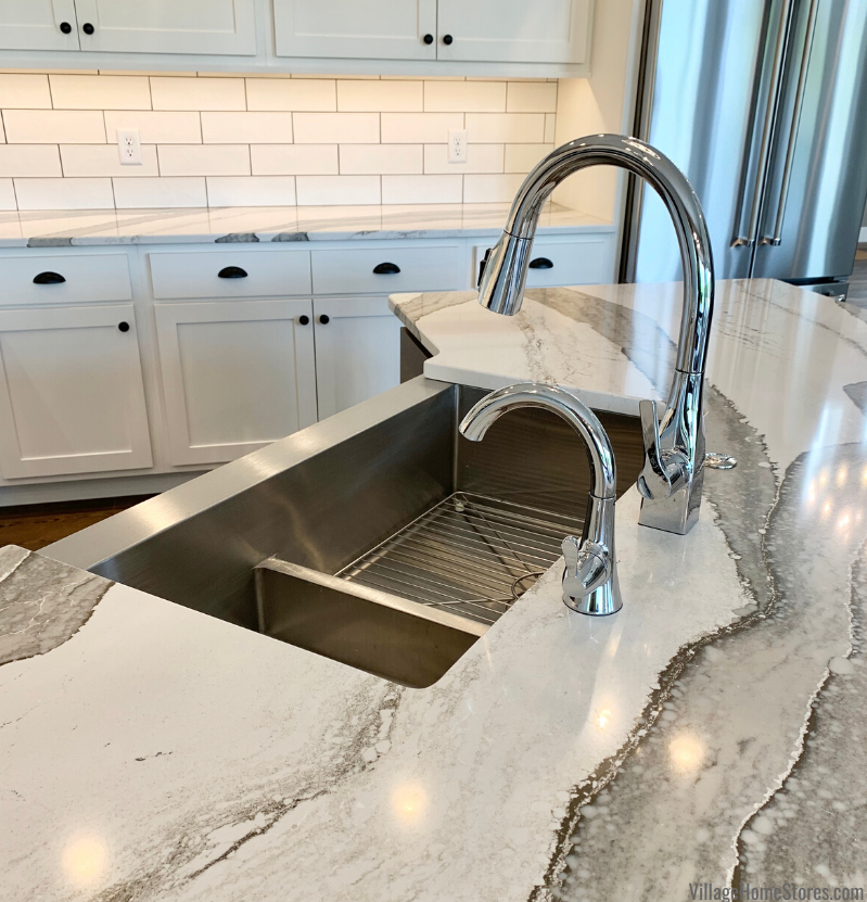 Stainless Steel low divide farm sink installed in Skara Brae cambria tops. New home in Aledo, IL with design and materials by Village Home Stores.