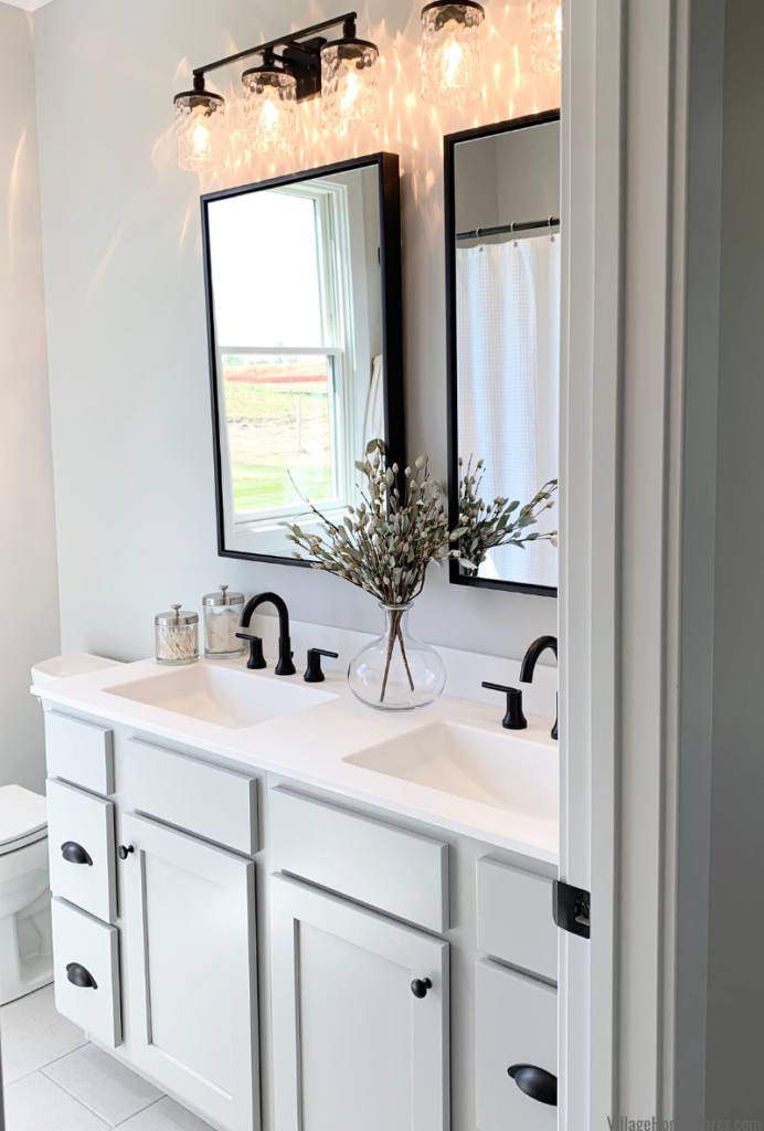 "Bathroom vanity in light gray ""Dusk"" painted finish with matte white Onyx Collection tops and matte black pull hardware"