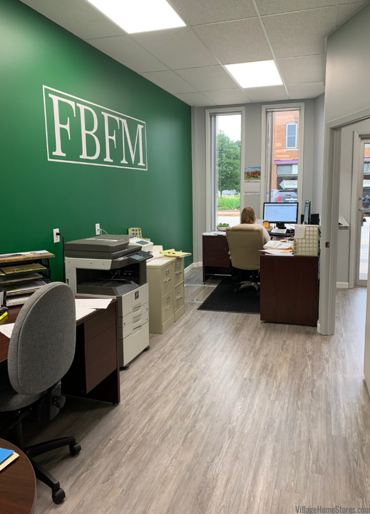 Storefront office remodel with vinyl plank floating floor. Flooring and complete remodel by Village Home Stores for IL Farm Business Farm Management