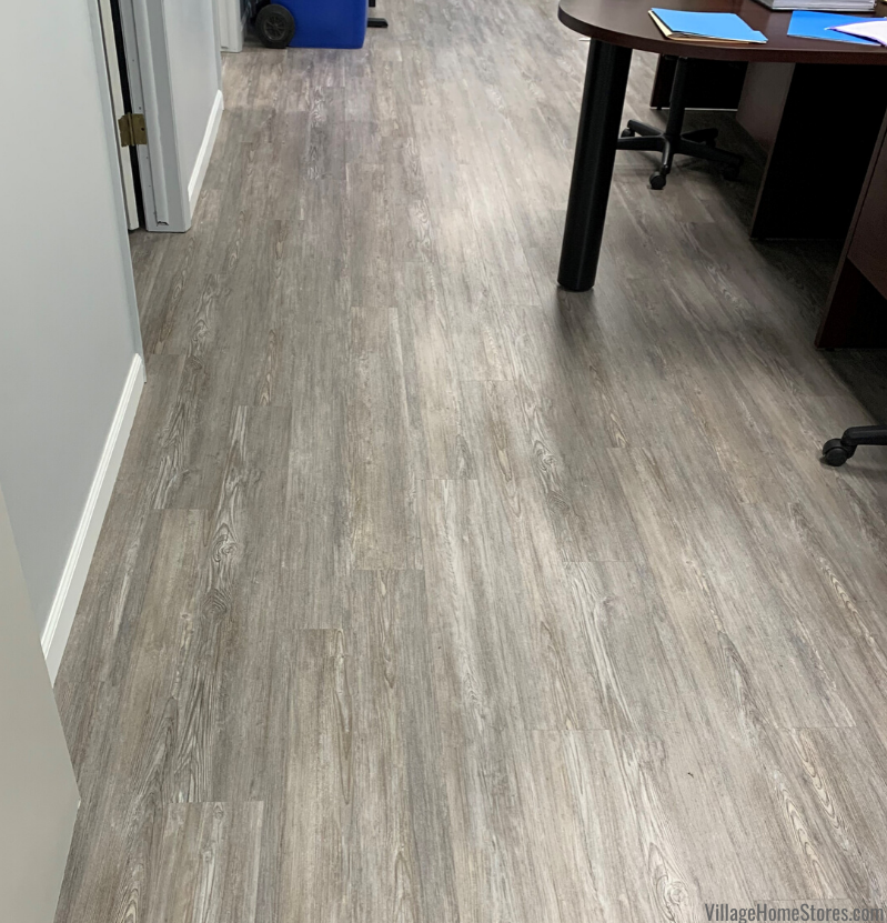 Gray wood grain look Armstrong luxury vinyl plank floating floor in an Atkinson, IL business. Flooring and remodel by Village Home Stores.