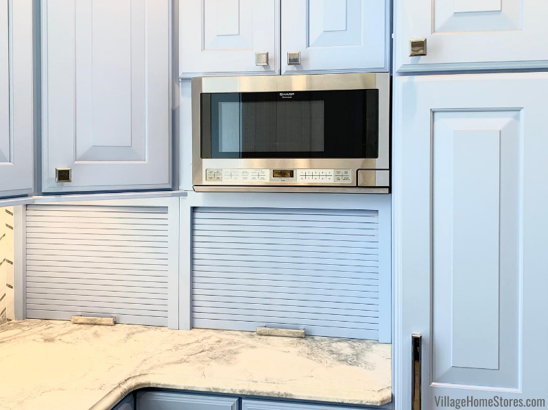 Kitchen remodel with custom painted blue cabinets and dual appliance garages.