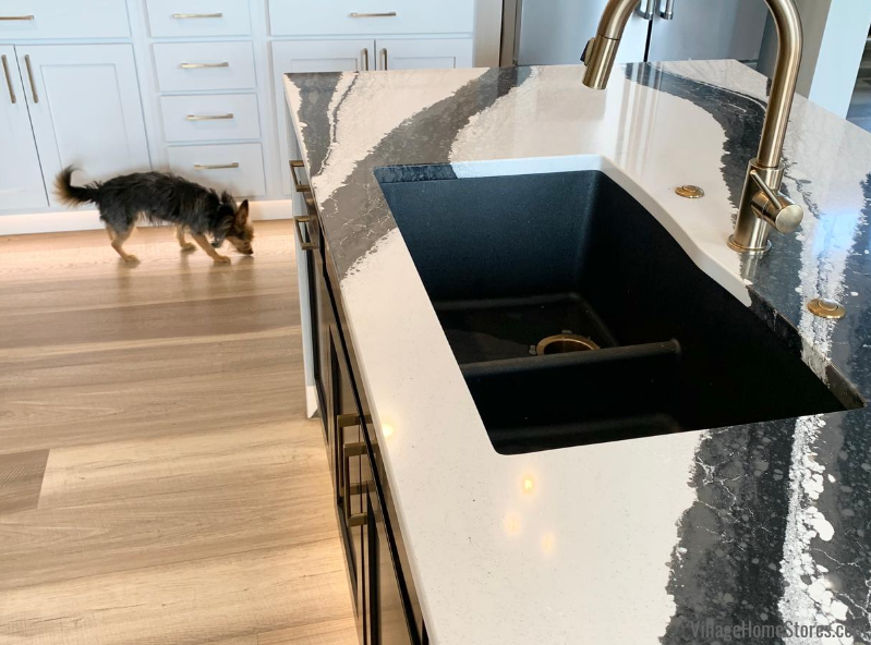 Elkay E Granite sink in matte black finish installed in Cambria Bentley quartz tops with Delta Champagne Bronze faucet.
