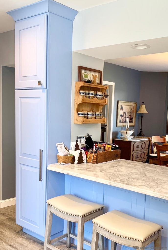 Blue tall pantry cabinet in a DuraSupreme kitchen in rural Illinois. Design, materials, and complete remodel from Village Home Stores.