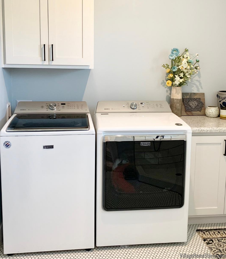 Maytag top load large capacity laundry in black and white farmhouse style laundry room