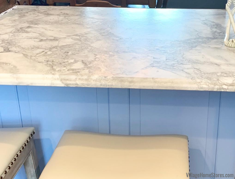 Super White natural stone installed in a matte brushed finish with an Ogee edge. Kitchen design, materials, and complete remodel from Village Home Stores.