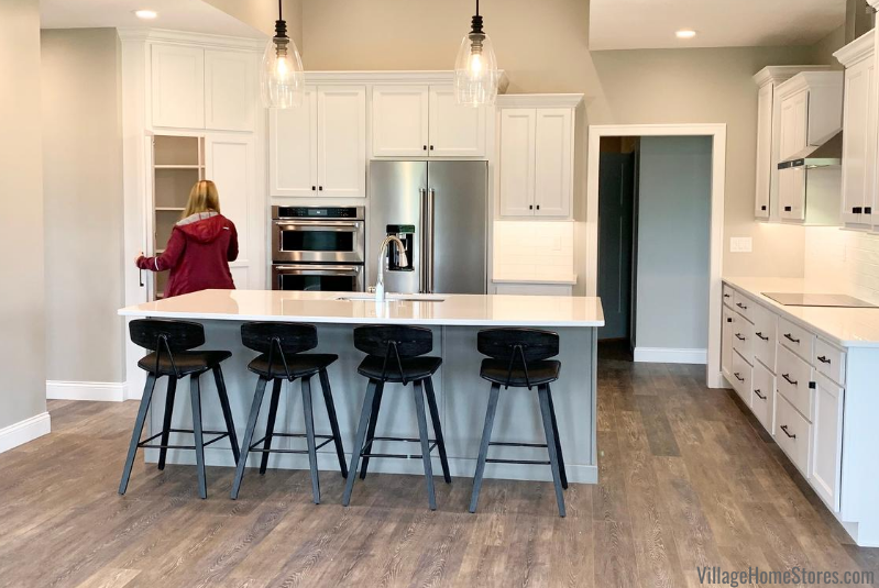 Kitchen design with large island and corner walk in pantry. Design and products by Village Home Stores for Hazelwood Homes.