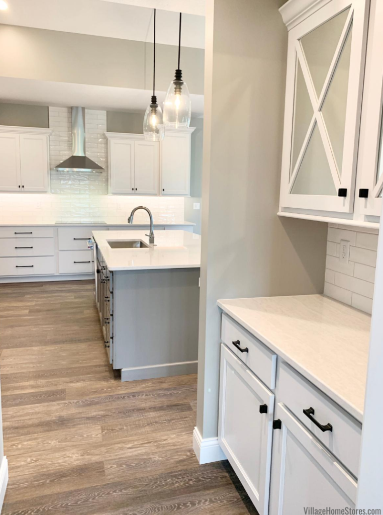 Kitchen design with large island and butler's pantry. Design and products by Village Home Stores for Hazelwood Homes.