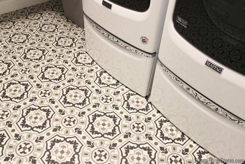 White and chrome Maytag front load washers on farmhouse inspired Tapestry vinyl flooring by Mannington.