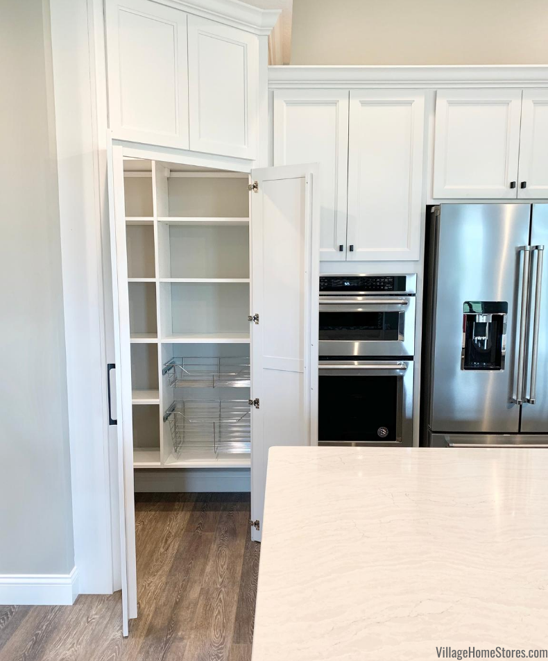 Walk through corner pantry kitchen design. Design and products by Village Home Stores for Hazelwood Homes.