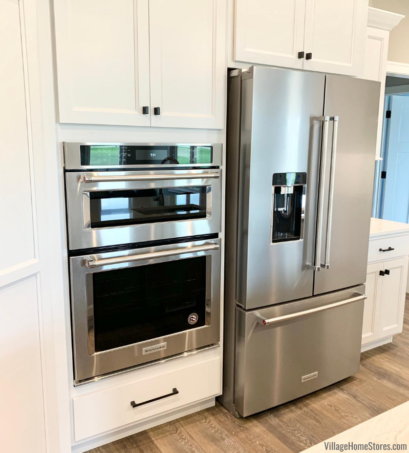 KitchenAid counter depth french door refrigerator and combination wall oven and microwave.